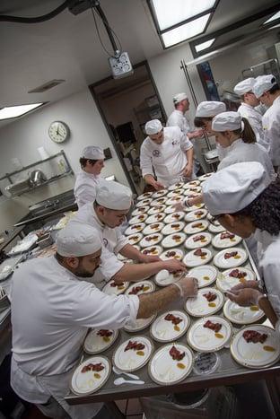 culinary_students_preparing_delicious_dish.jpg
