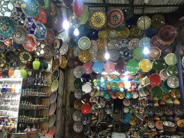 jjc students study abroad in morocco ceramics vendor in Marrakech joliet junior college