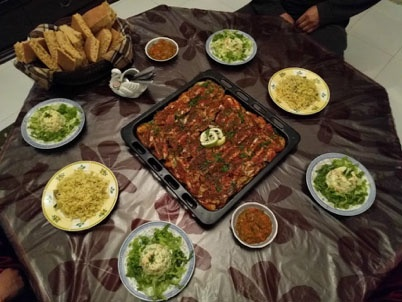 jjc students study abroad in morocco host family meal joliet junior college
