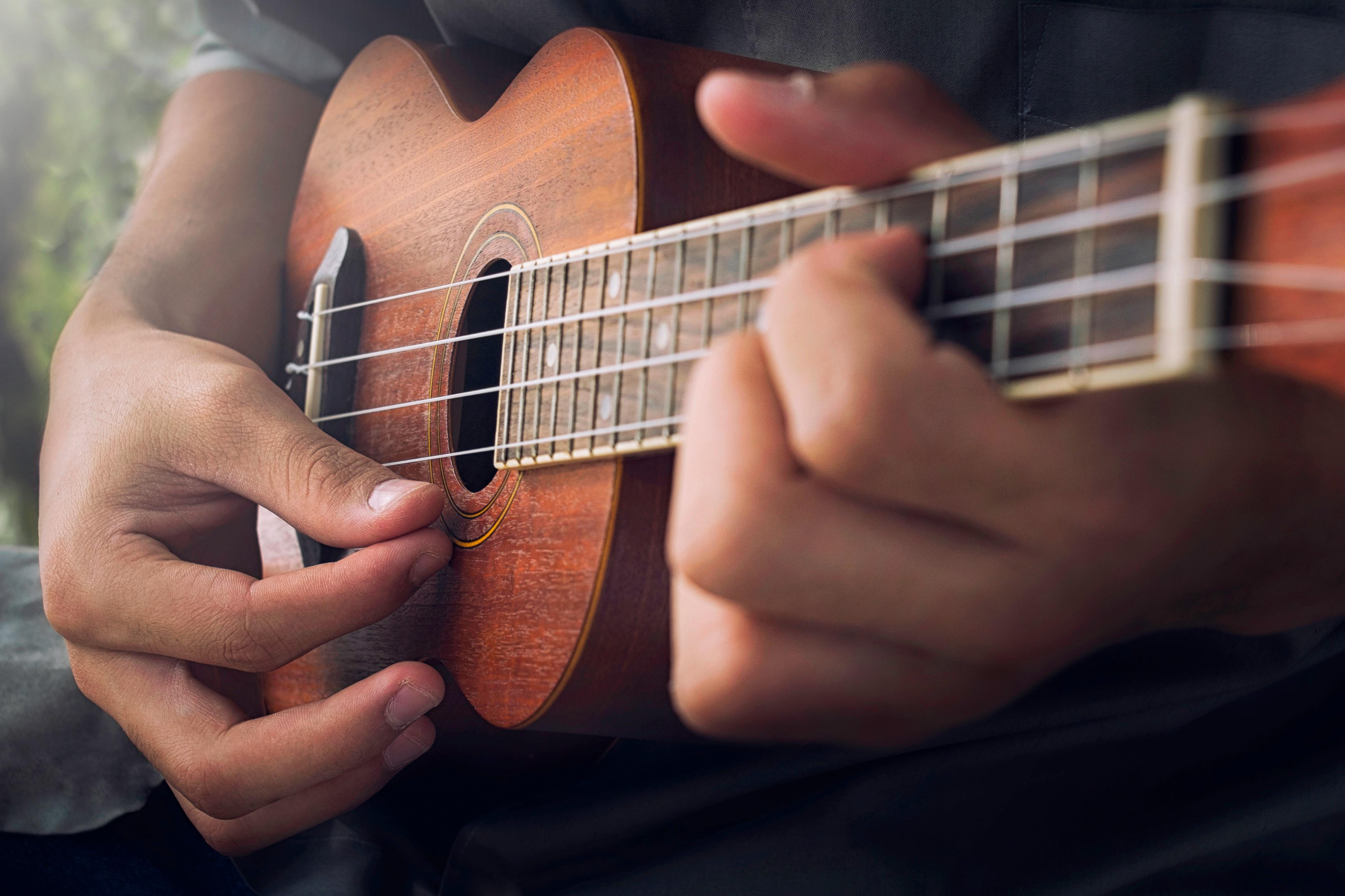 playing ukulele